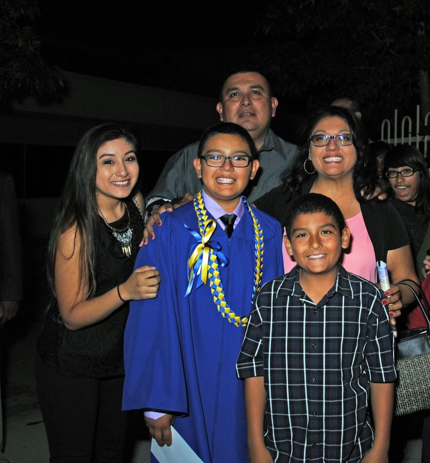 Jacob with Alex, Ruben, Andrew, graduation 8th grade, St. Pius