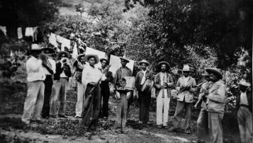 030 El Rincon musicians. Tio Beto with rifle