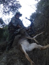 Jarv with his bow hunt buck