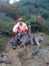 JoJo with his second deer, Glendora, in the rain