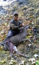 JoJo with bow hunt buck