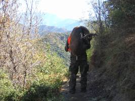 Tacho with his buck at Williams Canyon, Glendora, packing him out