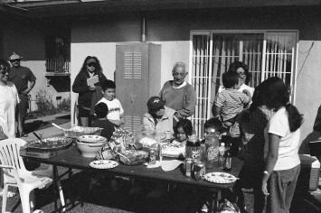 Family enjoying pit BBQ