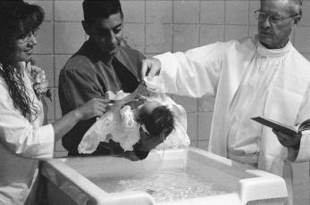 Miranda's baptism with Nino Tacho